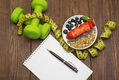 Dumbells, tape measure and healthy food. Fitness stock photography