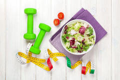 Dumbells, tape measure and healthy food Stock Images