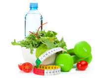 Dumbells, tape measure and healthy food. Fitness and health Royalty Free Stock Images