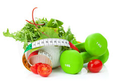 Dumbells, tape measure and healthy food. Fitness and health Stock Image
