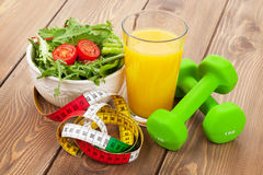 Dumbells, tape measure and healthy food. Fitness and health Royalty Free Stock Image