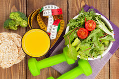 Dumbells, tape measure and healthy food. Fitness and health Stock Images