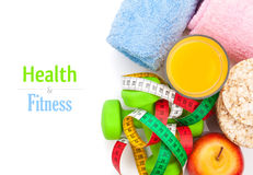 Dumbells, tape measure, healthy food and towels. Fitness and hea Royalty Free Stock Image