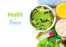 Dumbells, tape measure, healthy food and towels. Fitness and health stock photo