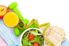 Dumbells, tape measure, healthy food and towels. Fitness and hea Royalty Free Stock Photography