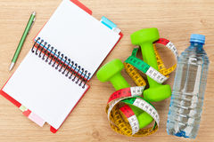 Dumbells, tape measure and notepad for copy space. Fitness and h Royalty Free Stock Image