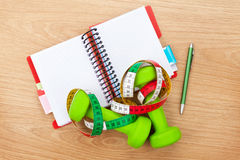 Dumbells, tape measure and notepad for copy space. Fitness and h Stock Images