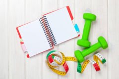 Dumbells, tape measure and notepad for copy space Stock Image
