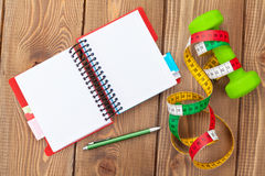 Dumbells, tape measure and notepad for copy space Royalty Free Stock Photos