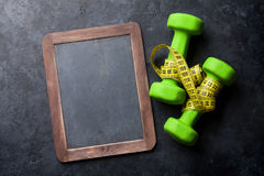 Dumbells and tape measure Stock Photos