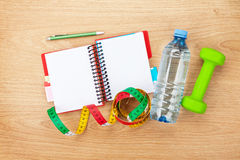 Dumbells, tape measure, water bottle and notepad for copy space Stock Photo