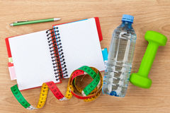 Dumbells, tape measure, water bottle and notepad for copy space Stock Photos