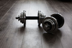 Dumbells on wooden floor. Two dumbbells for fitness. See my other works in portfolio Stock Photography