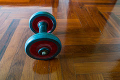 Dumbells on wooden Royalty Free Stock Image