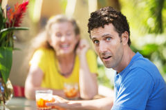 Dumbfounded Man with Woman on Vacation Stock Image