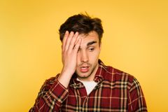 Dumbfounded shocked man clutch head dismay emotion stock photography