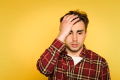 Regret remorse dismay man emotion clutch head. Dumbfounded and taken aback man clutching his head and panicking. feelings of regret remorse and dismay. portrait stock images