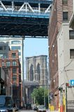 DUMBO -- a trendy neighborhood in New York City. DUMBO is an acronym for Down Under the Manhattan Bridge. The neighborhood of old warehouses by the river is royalty free stock photography
