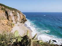 Dume Cove Malibu Beach, August 14, 2017: view from Dume Point overlook at Zuma Beach, emerald and blue water in a quite paradise b. Each surrounded by cliffs and Stock Photo