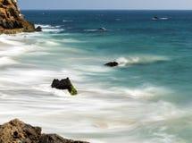 Dume Cove Malibu, Zuma Beach, emerald and blue water in a quite paradise beach surrounded by cliffs. Dume Cove, Malibu, California. CA, USA Stock Images