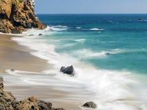Dume Cove Malibu, Zuma Beach, emerald and blue water in a quite paradise beach surrounded by cliffs. Dume Cove, Malibu, California. CA, USA Royalty Free Stock Photo