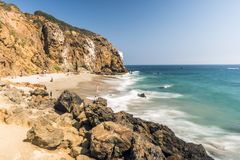 Dume Cove Malibu, Zuma Beach, emerald and blue water in a quite paradise beach surrounded by cliffs. Dume Cove, Malibu, California Stock Photos