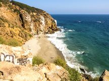 Dume Cove Malibu, Zuma Beach, emerald and blue water in a quite paradise beach surrounded by cliffs. Dume Cove, Malibu, California Stock Image