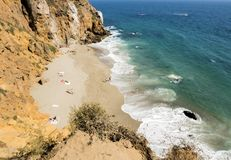 Dume Cove Malibu, Zuma Beach, emerald and blue water in a quite paradise beach surrounded by cliffs. Dume Cove, Malibu, California Royalty Free Stock Photo