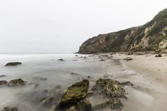 Dume Cove with Motion Blur Waves in Malibu California. Dume Cove with motion blur waves and clouds in Malibu, California Stock Image