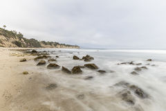 Dume Cove Tidal Pool Rocks with Motion Blur Malibu California. Dume Cove tidal pool rocks with motion blur in Malibu, California Stock Images