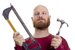 Dummer Mann mit Hammer und Säge Stockbild