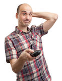 Dummer Mann schaut Fernsehapparat Stockfoto