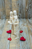 Dummies couple embracing love of wood Royalty Free Stock Photos