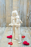 Dummies couple embracing love of wood Royalty Free Stock Images
