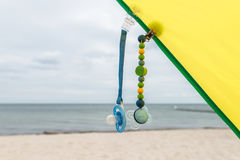 Dummies on dummy chains on the beach.  stock images