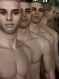 Dummies in line. Dummies in a dummy factory Royalty Free Stock Photo