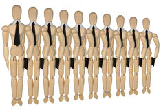 Dummies in a row - more of the same men. Several dummies - many of the same men in white collars and ties are one after the other Royalty Free Stock Photo