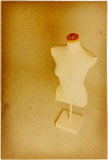 Dummy. Dressmaker's dummy on aged paper royalty free stock photo