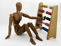 Dummy with abacus royalty free stock photos