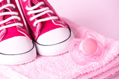 Dummy and baby shoes Royalty Free Stock Photo