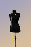 Dummy. Black mannequin with a ruler for sewing Royalty Free Stock Image