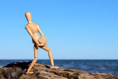 Dummy carries a heavy stone Royalty Free Stock Photos