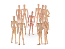 Dummy characters. Different one in center of the crowd. royalty free stock photos