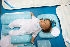 Dummy of Child lies in crib. Top view. Royalty Free Stock Image
