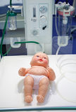 Dummy of child in medical box Stock Photos