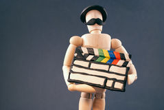 Dummy and cinema clap board. Royalty Free Stock Image