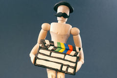 Dummy and cinema clap board. Royalty Free Stock Images