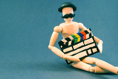 Dummy and cinema clap board. Stock Image