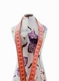 Dummy clothing with measuring tape isolated on white background Royalty Free Stock Image