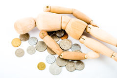 Dummy with coins Stock Photo